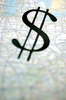 Close-up of a dollar sign on a globe