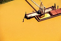 Loading grain in Mississippi River, shot from above.