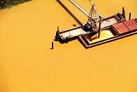 Loading grain in Mississippi River, shot from above.