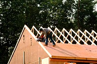 Workers putting roof on new home, Anne Arundel County, Maryland