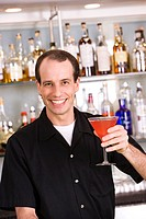 Portrait of a mid adult man holding a cocktail