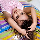 High angle view of a girl lying on an inflatable ball (thumbnail)