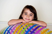 Portrait of a girl leaning on an inflatable ball