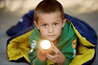 Portrait of a boy holding a flashlight