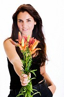 Portrait of a young woman holding a bunch of flowers