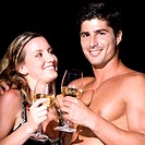 Close-up of a young couple holding wineglasses