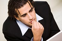 Close-up of a businessman with his finger on his lips (thumbnail)