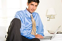 Portrait of a businessman working on a laptop (thumbnail)