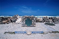 Cape Agulhas marker. Tourist marker at the point dividing the Indian Ocean (left) and the Atlantic Ocean (right) at Cape Agulhas, South Africa. This i...