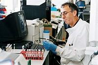 Pathologist in his lab analysing blood sample.