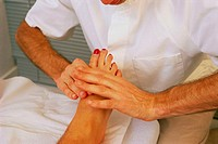 : McTimoney chiropractic. The chiropractor adjusts the bones of the foot. McTimoney chiropractic is a system of adjustment by hand of minor displaceme...