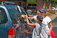 Teen church group has a donation car wash to help victims of Katrina Hurricane in LA Gulf Coast of USA
