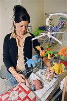 Mother on Neonatal unit feeding premature oxygen dependent baby, which was born at 28 weeks and is now 17 weeks old, using tube,