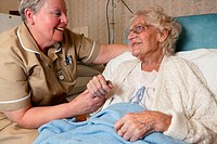 Female Orthopaedic Auxiliary Nurse talking to patient,