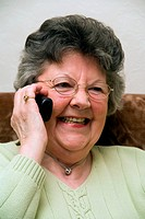 Woman chatting on the telephone, smiling