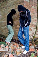 Two teenagers hanging around on the street