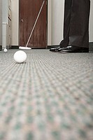 Business man practicing putting