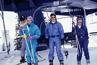 Skiers leaving chair lift
