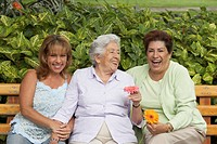 Portrait of three women sitting on a bench