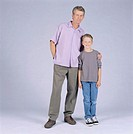 Father and son (10-11) standing in studio, portrait