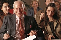 Businesspeople in meeting, smiling