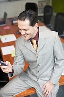 High angle view of a businessman operating a mobile phone