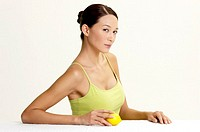 Woman holding a lemon
