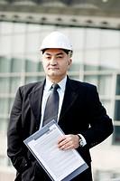 Senior businessman wearing a safety helmet.
