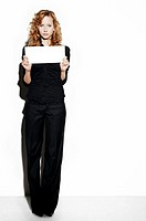 Businesswoman holding a blank piece paper