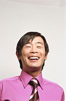 Businessman laughing, portrait