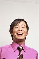 Businessman laughing, portrait