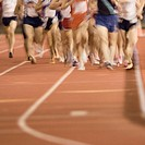 Track athletes running on track (blurred motion), low section