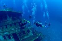 Scuba divers enter shipwreck. Roatán, Honduras