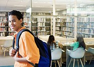 Teenage boy posing in library (thumbnail)
