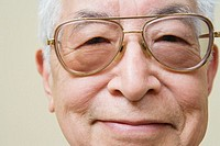 Close up portrait of elderly man wearing glasses