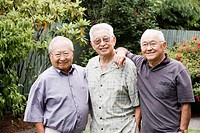 Portrait of three elderly men standing outside together