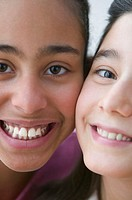 Close up of part of two girls faces smiling