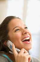 Teenage girl laughing on cell phone