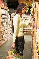 African American woman shopping in health food store