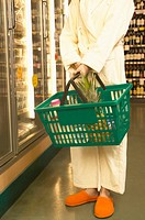 Woman in bathrobe and slippers at grocery store