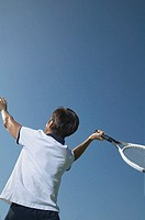 Woman swinging tennis racket