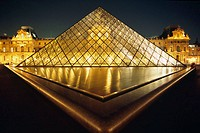 The Pyramid of the Le Grand Louvre Art Gallery and Cour Napolean by night in Paris, Ile de France, France.
