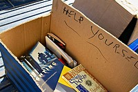 Texas, Austin. Cardboard box with books on blue bench, Help Yourself written on box, give away, free for the taking