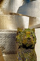 Guggenheim Museum by Frank O. Gehry with 'Puppy', sculpture by Jeff Koons, at fore. Bilbao. Biscay, Spain