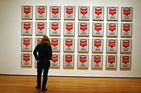 Woman in museum admiring Warhol´s Campbell´s Soup Series.