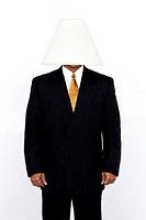 Businessman with a lamp covering his head