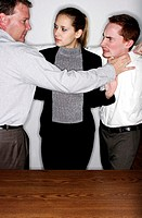 Businesswoman trying to cool off two angry men (thumbnail)