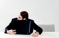 Businessman sleeping on briefcase