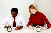 Businesswoman copying her colleague´s work during a test.