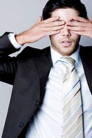 Businessman closing his eyes with his hands